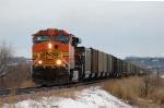 BNSF 5639, AC44CW, leads a westbound empty hopper train